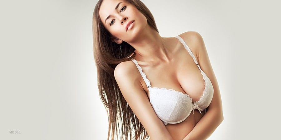 Sexy Model with Large Breasts in White Lace Bra