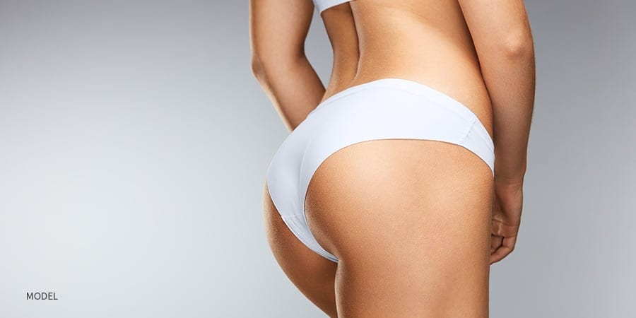 Close Up of Round Female Buttocks in White Panties